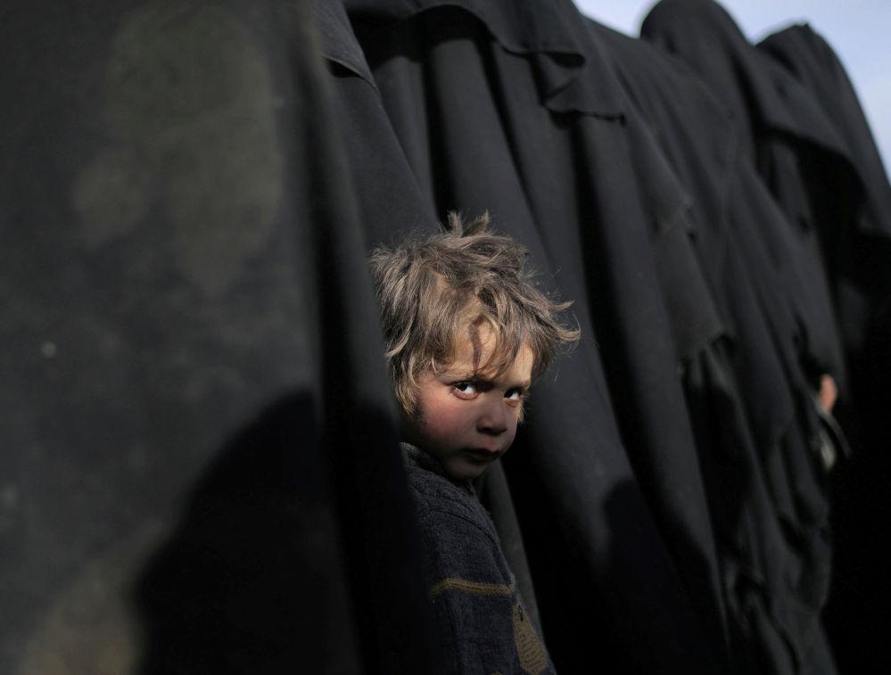 Сирийский мальчик в городе Багхуз