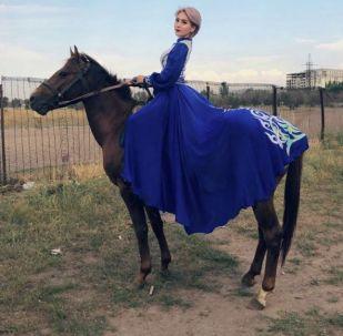 Сауд Аравиядагы Camel Fest фестивалына даярдык көрүп жатканда кырсыктаган кыргызстандык жаачы кыз Асланайым Аширова