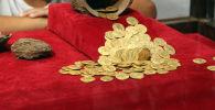 Золотые монеты. Архивное фото