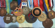 Медали бронзового призера Олимпийских игр Руслана Тюменбаева. Архивное фото