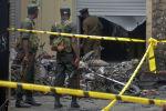Военные Шри-Ланки на месте взрыва в церкви в Баттикалоа, 21 апреля 2019 года