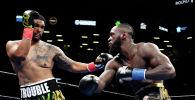 Поединок между боксерами Деонтеем Уайлдером и Домиником Бризилой на чемпионате мира по боксу в супертяжелом весе в Barclays Center.  18 мая 2019 года
