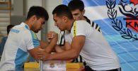 Участники чемпионата Азии по армрестлингу в городе Чолпон-Ата Иссык-Кульской области. 11 июня 2019 года