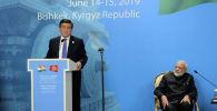 Президент Кыргызской Республики Сооронбай Жээнбеков во время выступления на кыргызско-индийском бизнес-форуме, организованном в рамках официального визита Премьер-министра Республики Индия Нарендра Моди. 14 июня 2019 года