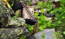 Оружие и боеприпасы с тайника. Архивное фото