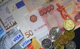 Рубль жана доллар акчалары. Архивдик сүрөт