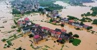 Затопленные здания после сильного дождя, вызвавшего наводнение в Хэнъяне в провинции Хунань в центральном Китае. 9 июля 2019 года