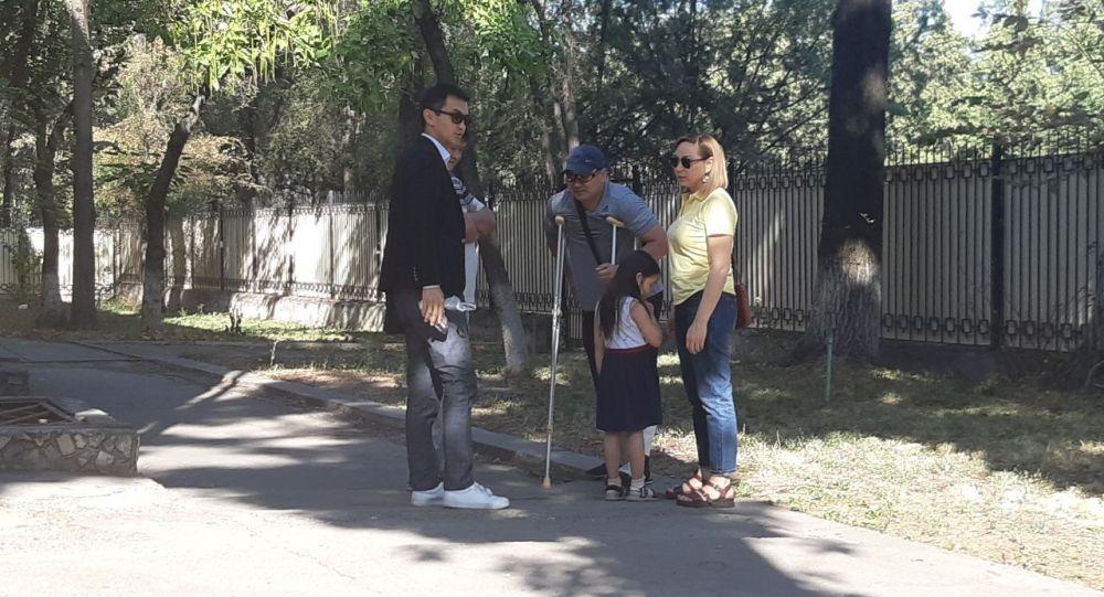 Советник бывшего президента Кундуз Жолдубаева и его старший сын Сейитбек Атамбаев