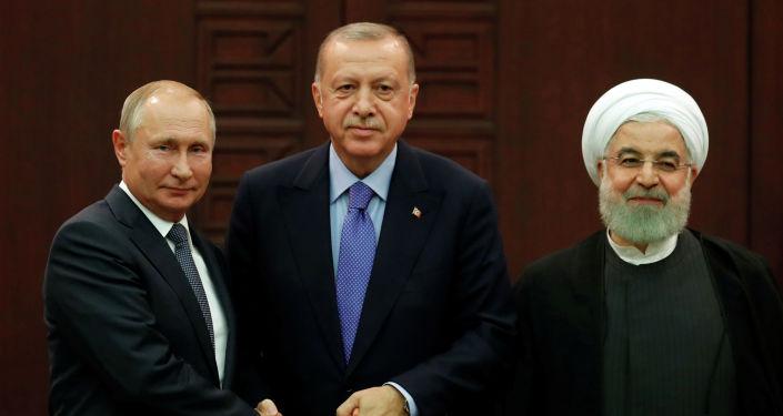 Президенты России, Турции и Ирана — Владимир Путин, Реджеп Тайип Эрдоган и Хасан Роухани на трехсторонних переговорах по урегулированию конфликта в Сирии в Анкаре. 16 сентября 2019 года