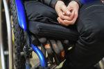 Женщина в инвалидной коляске. Архивное фото