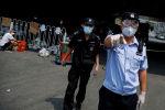 Сотрудники полиции и службы безопасности Китая. Архивное фото