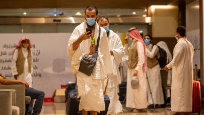Паломники в защитных масках в священном городе Мекка. Архивное фото
