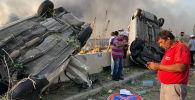 Бейруттун портунда катуу жарылуу учурунда. Архив