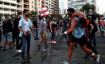 Акции протеста после мощного взрыва в районе порта Бейрута