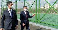 Президент Сооронбай Жээнбеков жана Бишкек шаарынын мэри Азиз Суракматовдун архивдик сүрөтү