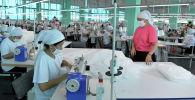 Текстиль фабрикасынын жумушчулары