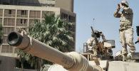 Американские солдаты наблюдают за порядком на улице Багдада. Архивное фото