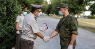 На территории российской авиабазы в Канте состоялись проводы российских военных врачей.