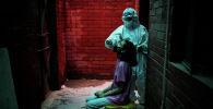 Нью-Дели шаарында коронавируска анализ алуу. Архивдик сүрөт