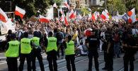 Протестные акции населения против ограничительных мер, введенных властями на фоне пандемии коронавируса в Варшаве, Польша