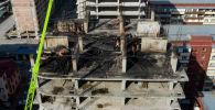 Минувшей ночью в Джале пылал строящийся многоквартирный дом. Как выглядит здание после пожара, смотрите в видео Sputnik Кыргызстан.
