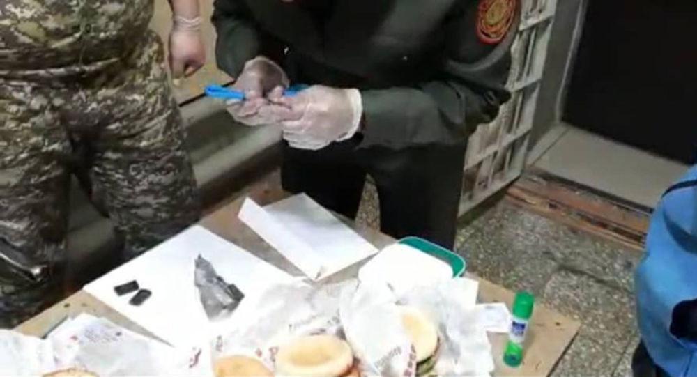 Попытка передачи наркотики в гамбургерах в СИЗО №1