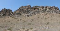 Оштун Кара-Суу районуна караштуу Кызыл-Кыштак айыл аймагындагы Сүрөттүү-Таш археологиялык эстелиги
