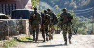 Вооруженные мужчины в селе Чанахчи в Нагорном Карабахе.