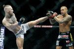 Бойцы UFC Конор МакГрегор (слева) бьет Дастина Пуарье ногой во время их боя в Лас-Вегасе. 27 сентября 2014 года