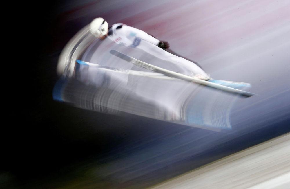Канадалык спортчу Маккензи Бойд-Клоуз трамплинден секирүү боюнча дүйнө кубогунда, Висла (Польша)