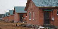 Строительство домов. Архивное фото