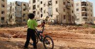 Мальчик в лагере беженцев в Алеппо. Архивное фото