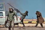 Боец оппозиции стреляет из пулемета в истребитель в городе Рас-Лануф в Ливии. Архивнео фото