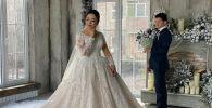 Чемпион мира по вольной борьбе  Улукбек Жолдошбеков с невестой во время фотосессии