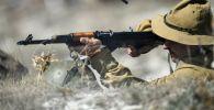 Участник реконструкции эпизода Афганской войны. Архивное фото