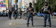 Иракские силы безопасности охраняют место двойного теракта на центральном рынке в Багдаде