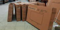 Телевизоры в коробках. Архивное фото