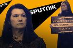 Латвиядагы журналисттерге басым кылууну токтоткула деген чакырык менен Мария Бутина ТИМдин Кабыл алуу үйүнүн алдына келип турду.