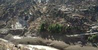 Вид на поврежденную плотину после прорыва и врезания в плотину гималайского ледника в деревне Райни Чак Лата в районе Чамоли в северном штате Уттаракханд