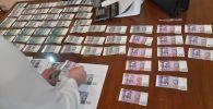 С поличным по факту вымогательства и получения взятки задержан председатель правления ОАО Кыргызалтын