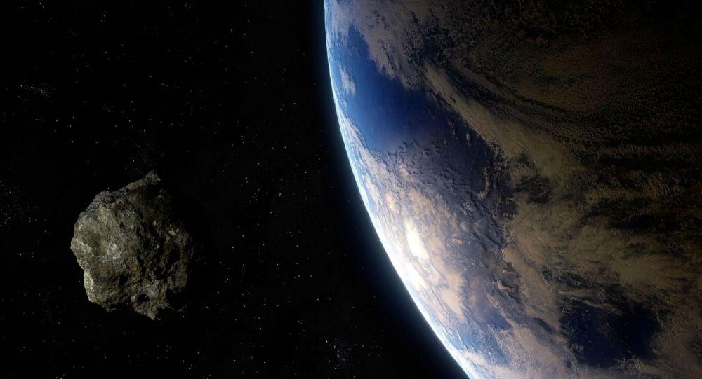 Астероид приближающийся к земле. Иллюстративное фото