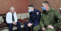 Военнослужащие российской военной базы в Канте поздравили ветеранов военно-воздушных сил с наступающим Днем защитника Отечества