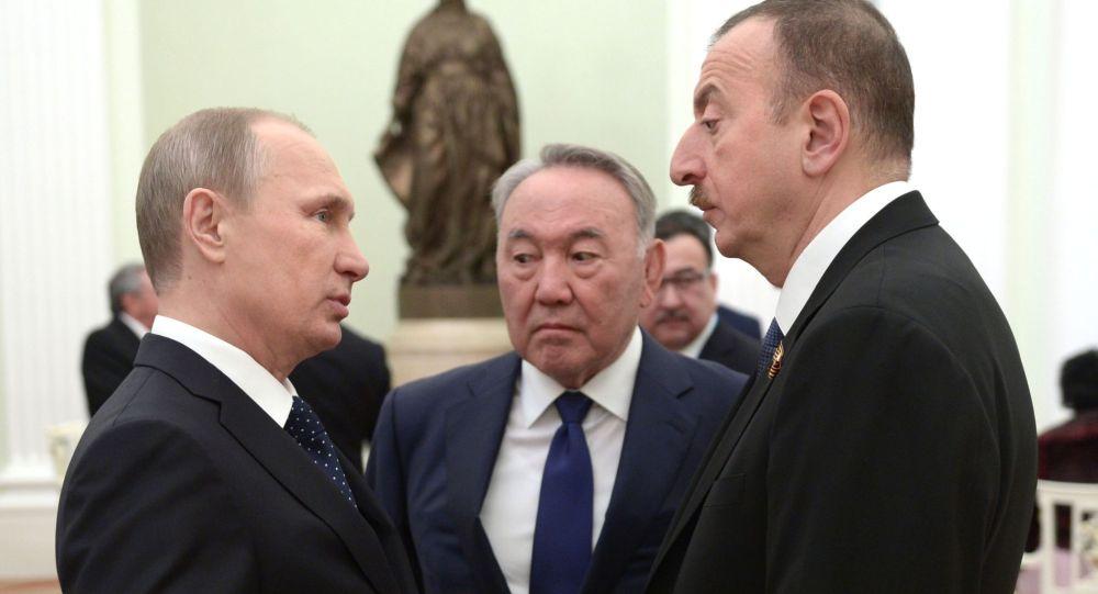 Президент РФ Владимир Путин, первый президент Казахстана Нурсултан Назарбаев и президент Азербайджана Ильхам Алиев. Архивное фото