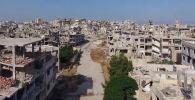 Сириянын Хомс шаарындагы талкаланган имараттар, жан адам жашабай калган көрүнүш кинофильмдеги фрагменттерди элестеткени менен бул реалдуу абал.