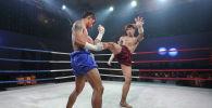 Показательный поединок по тайскому боксу. Архивное фото