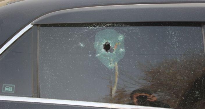 Расстрелянный автомобиль в Узгене, где были убиты два человека. 19 марта 2021 года