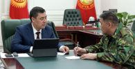 Президент КР Садыр Жапаров и председатель ГКНБ Камчыбек Ташиев. Архивное фото