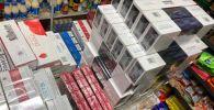 На центральном рынке Токмока в ходе рейдового налогового контроля изъято более 4500 пачек сигарет без акцизных марок