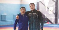 Кыргызстандык грек-рим күрөшүнүн балбандары Жоламан Шаршенбеков жана Акжол Махмудов. Архивдик сүрөт