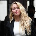 Американская актриса Эмбер Херд прибывает в суд по делу о клевете, возбужденном против ее бывшего мужа американского актера Джонни Деппа в Лондоне. 27 июля 2020 года